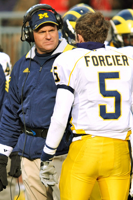 COLUMBUS, OH - NOVEMBER 27:  Head Coach Rich Rodriguez of the Michigan Wolverines talks to quarterback Tate Forcier #5 of the Michigan Wolverines during a game against Ohio State Buckeyes at Ohio Stadium on November 27, 2010 in Columbus, Ohio.  (Photo by