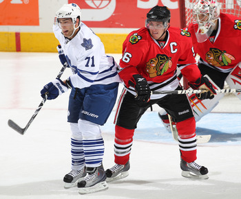 LONDON, CANADA - SEPTEMBER 11:  Jerry D'Amigo #71 of the Toronto Maple Leafs looks to tip a shot next to Brian Connelly #56 of the Chicago Black Hawks in a game during the NHL Rookie Tournament on September 11,2010 at the John Labatt Centre in London,Onta