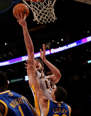 LOS ANGELES - NOVEMBER 21:  Pau Gasol #16 of the Los Angeles Lakers shoots over Stephen Curry #30 of the Golden State Warriors at Staples Center on November 21, 2010 in Los Angeles, California. The Lakers won 117-89. NOTE TO USER: User expressly acknowled