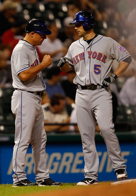 CLEVELAND - JUNE 17:  David Wright #5 of the New York Mets is congratulated at third base by Chip Hale #51 during the game against the Cleveland Indians on June 17, 2010 at Progressive Field in Cleveland, Ohio.  (Photo by Jared Wickerham/Getty Images)