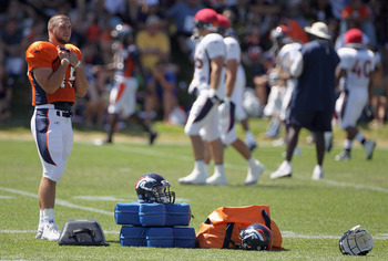ENGLEWOOD, CO - AUGUST 18:  Rookie quarterback Tim Tebow #15 of the Denver Broncos looks on during training camp practice at Dove Valley on August 18, 2010 in Englewood, Colorado.  (Photo by Doug Pensinger/Getty Images)