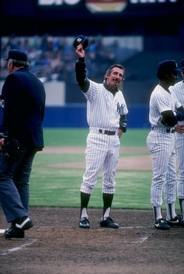 Manager Billy Martin of the New York Yankees waves to the crowd at Yankee Stadium in the Bronx, New York.