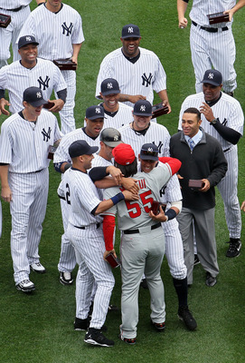 NEW YORK - APRIL 13:  Hideki Matsui #55 of the Los Angeles Angels of Anaheim is greeted by former teammates Alex Rodriguez #13, Derek Jeter #2, Jorge Posada #20, Robinson Cano #24, Joba Chamberlain #62 and Mariano Rivera #42 of the New York Yankees after