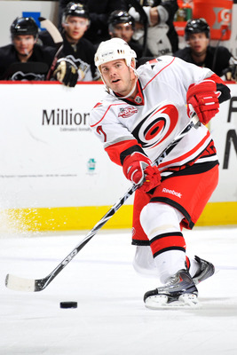 PITTSBURGH - NOVEMBER 19:  Ian White #7 of the Carolina Hurricanes skates with the puck against the Pittsburgh Penguins on November 19, 2010 at Consol Energy Center in Pittsburgh, Pennsylvania. White made his debut in a Carolina uniform after being traded