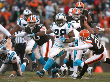 CLEVELAND - NOVEMBER 28:  Running back Jonathan Stewart #28 of the Carolina Panthers runs by defensive back Sheldon Brown #24 and linebacker Eric Barton #50 of the Cleveland Browns at Cleveland Browns Stadium on November 28, 2010 in Cleveland, Ohio.  (Pho