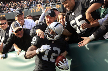 OAKLAND, CA - NOVEMBER 28:  Jacoby Ford #12 of the Oakland Raiders is congratulated by fan after he scored a touchdown against the Miami Dolphins at Oakland-Alameda County Coliseum on November 28, 2010 in Oakland, California.  (Photo by Ezra Shaw/Getty Im