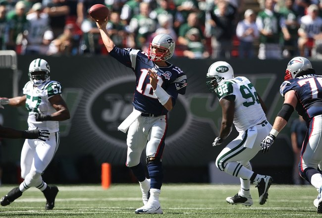 EAST RUTHERFORD, NJ - SEPTEMBER 20:  Tom Brady #12 of the New England Patriots passes against the New York Jets at Giants Stadium on September 20, 2009 in East Rutherford, New Jersey.  (Photo by Nick Laham/Getty Images)