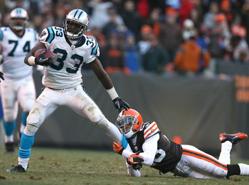 CLEVELAND - NOVEMBER 28:  running back Mike Goodson #33 of the Carolina Panthers is hit by defensive back Joe Haden #23 of the Cleveland Browns at Cleveland Browns Stadium on November 28, 2010 in Cleveland, Ohio.  (Photo by Matt Sullivan/Getty Images)