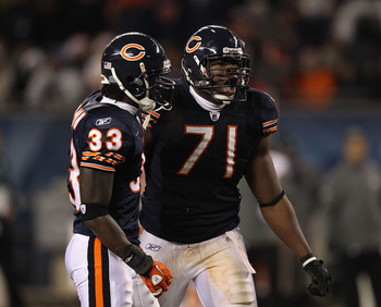 CHICAGO - NOVEMBER 28: Charles Tillman #33 and Israel Idonije #71 of the Chicago Bears celebrate a defensive stop against the Philadelphia Eagles at Soldier Field on November 28, 2010 in Chicago, Illinois. The Bears defeated the Eagles 31-26. (Photo by Jo