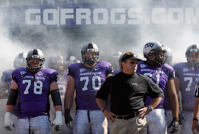 FORT WORTH, TX - OCTOBER 16:  Head coach Gary Patterson of the TCU Horned Frogs takes to the field with offensive guard Josh Vernon #78 and tackle Zach Roth #70 against the BYU Cougars at Amon G. Carter Stadium on October 16, 2010 in Fort Worth, Texas.  (