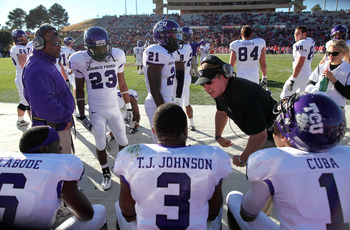 ALBUQUERQUE, NM - NOVEMBER 27: Head coach Gary Patterson (R) of the TCU Horned Frogs with his team on the sidelines during their 66-17 win over the University of New Mexico Lobos on November 27, 2010 at University Stadium in Albuquerque, New Mexico. (Phot