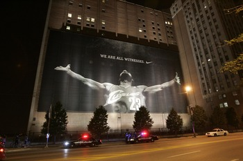 CLEVELAND - JULY 8:  Police stand guard near a larger than life photograph of LeBron James after the announcement that James will play next season for the Miami Heat July 8, 2010 in Cleveland, Ohio. The two-time Most Valuable Player made the choice to pla