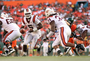 MIAMI - NOVEMBER 20:  Tyrod Taylor #5 of the Virginia Tech Hokies hands the ball off to teammate Ryan Williams #34 during a game against the Miami Hurricanes at Sun Life Stadium on November 20, 2010 in Miami, Florida.  (Photo by Mike Ehrmann/Getty Images)