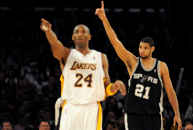 LOS ANGELES, CA - JANUARY 25:  Tim Duncan #21 of the San Antonio Spurs reacts to a foul next to Kobe Bryant #24 of the Los Angeles Lakers during the forth quarter at the Staples Center on January 25, 2009 in Los Angeles, California.  The Lakers defeated t