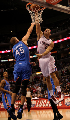 LOS ANGELES - NOVEMBER 3:  Blake Griffin #32 of the Los Angeles Clippers goes up for a shot over Cole Aldrich #45 of the Oklahoma City Thunder at Staples Center on November 3, 2010 in Los Angeles, California. The Clippers won 107-92.  NOTE TO USER: User e