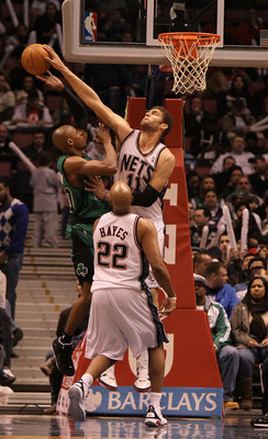 EAST RUTHERFORD, NJ - JANUARY 13:  Brook Lopez #11 of the New Jersey Nets blocks a shot against Ray Allen #20 of the Boston Celtics during their game on January 13th, 2010 at The Izod Center in East Rutherford, New Jersey. NOTE TO USER: User expressly ack