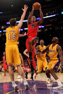 LOS ANGELES - NOVEMBER 5: DeMar DeRozan #10 of the Toronto Raptors goes up for a shot between Pau Gasol #16 and Lamar Odom #7 of the Los Angeles Lakers at Staples Center on November 5, 2010 in Los Angeles, California.  The Lakers won 108-102.   NOTE TO US