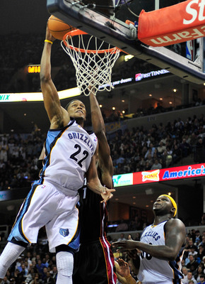 MEMPHIS, TN - NOVEMBER 20:  Rudy Gay #22 of the Memphis Grizzlies dunks over Chris Bosh #1 of the Miami Heat at FedExForum on November 20, 2010 in Memphis, Tennessee. The Grizzlies won 97-95. NOTE TO USER:  User expressly acknowledges and agrees that, by