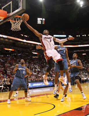 MIAMI, FL - NOVEMBER 29:  Dwyane Wade #3 of the Miami Heat shoots during a game against the Washington Wizards at American Airlines Arena on November 29, 2010 in Miami, Florida. NOTE TO USER: User expressly acknowledges and agrees that, by downloading and
