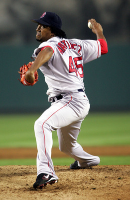 ANAHEIM, CA - OCTOBER 6:  Pitcher Pedro Martinez #45 of the Boston Red Sox delivers a pitch during the American League Division Series with the Anaheim Angels, Game Two on October 6, 2004 at Angels Stadium at Anaheim in Anaheim, California.   (Photo by St