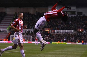 STOKE ON TRENT, ENGLAND - NOVEMBER 13:  Kenwyne Jones of Stoke City celebrates after scoring the second goal during the Barclays Premier League match between Stoke City and Liverpool at Britannia Stadium on November 13, 2010 in Stoke on Trent, England.  (