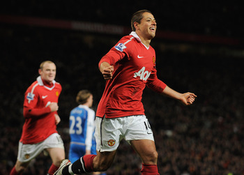 MANCHESTER, ENGLAND - NOVEMBER 20:  Javier Hernandez of Manchester United celebrates scoring to make it 2-0 during the Barclays Premier League match between Manchester United and Wigan Athletic at Old Trafford on November 20, 2010 in Manchester, England.
