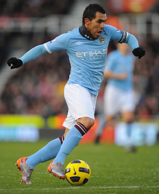 STOKE ON TRENT, ENGLAND - NOVEMBER 27:  Carlos Tevez of Manchester City in action during the Barclays Premier League match between Stoke City and Manchester City at Britannia Stadium on November 27, 2010 in Stoke on Trent, England.  (Photo by Clive Mason/