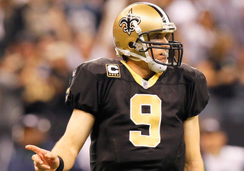 NEW ORLEANS - NOVEMBER 21:  Quarterback Drew Brees #9 of the New Orleans Saints signals a first down against the Seattle Seahawks at Louisiana Superdome on November 21, 2010 in New Orleans, Louisiana.  (Photo by Kevin C. Cox/Getty Images)