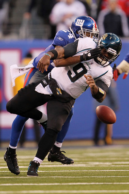 EAST RUTHERFORD, NJ - NOVEMBER 28:  David Garrard #9 of the Jacksonville Jaguars is sacked by Terrell Thomas #24 of the New York Giants at New Meadowlands Stadium on November 28, 2010 in East Rutherford, New Jersey.  (Photo by Chris McGrath/Getty Images)
