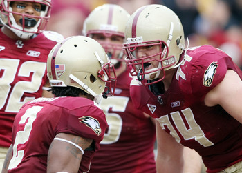 CHESTNUT HILL, MA - OCTOBER 03:  Anthony Castonzo #74 of the Boston College Eagles congratulates teammate Montel Harris #2 after Harris scored a touchdown in the first quarter against the Florida State Seminoles on October 3, 2009 at Alumni Stadium in Che