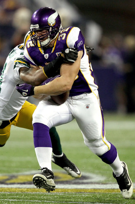 MINNEAPOLIS - NOVEMBER 21:  Toby Gerhart #32 of the Minnesota Vikings has the ball jarred loose by Charles Woodson #21 of the Green Bay Packers at the Hubert H. Humphrey Metrodome on November 21, 2010 in Minneapolis, Minnesota.  (Photo by Matthew Stockman