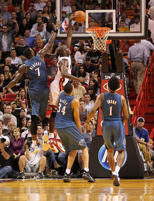 MIAMI, FL - NOVEMBER 29:  Joel Anthony #50 of the Miami Heat dunks over Andray Blatche #7 of the Washington Wizards during a game at American Airlines Arena on November 29, 2010 in Miami, Florida. NOTE TO USER: User expressly acknowledges and agrees that,