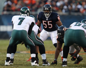 CHICAGO - NOVEMBER 28: Lance Briggs #55 of the Chicago Bears awaits the start of play as Michael Vick #7 of the Philadelphia Eagles calls the signals at Soldier Field on November 28, 2010 in Chicago, Illinois. The Bears defeated the Eagles 31-26. (Photo b