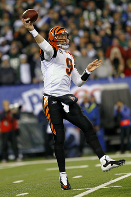 EAST RUTHERFORD, NJ - NOVEMBER 25: Quarterback Carson Palmer #9 throws a pass against the New York Jets at New Meadowlands Stadium on November 25, 2010 in East Rutherford, New Jersey.  (Photo by Chris Trotman/Getty Images)
