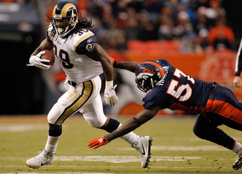 DENVER - NOVEMBER 28:  Running back Steven Jackson #39 of the St. Louis Rams escapes a diving effort by linebacker Mario Haggan #57 of the Denver Broncos on his way to a 20-yard gain during the third quarter at INVESCO Field at Mile High on November 28, 2