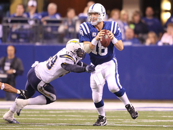 INDIANAPOLIS - NOVEMBER 28:  Peyton Manning #18 of the Indianapolis Colts looks to throw a pass while pursued by Kevin Burnett #99 of the San Diego Chargers during the NFL game at Lucas Oil Stadium on November 28, 2010 in Indianapolis, Indiana.  The Charg