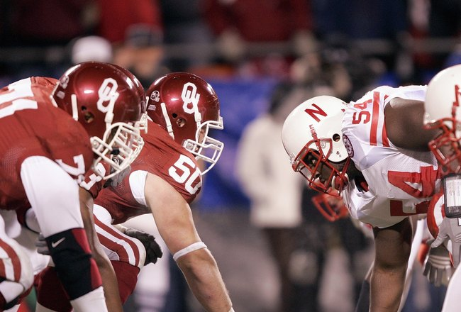 KANSAS CITY, MO - DECEMBER 2:  Center Jon Cooper #50 of the Oklahoma Sooners faces off against the Nebraska Cornhuskers during the 2006 Dr. Pepper Big 12 Championship on December 2, 2006 at Arrowhead Stadium in Kansas City, Missouri. The Sooners won 21-7.