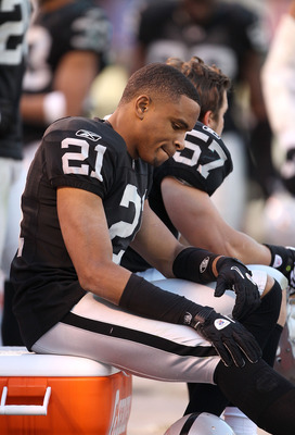 OAKLAND, CA - NOVEMBER 28:  Nnamdi Asomugha #21 of the Oakland Raiders sits on the bench during the closing minutes of their loss to the Miami Dolphins at Oakland-Alameda County Coliseum on November 28, 2010 in Oakland, California.  (Photo by Ezra Shaw/Ge