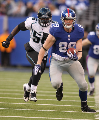 EAST RUTHERFORD, NJ - NOVEMBER 28:  Kevin Boss #89  of the New York Giants runs with the ball as Justin Durant #56 of the Jacksonville Jaguars trails during their game on November 28, 2010 at The New Meadowlands Stadium in East Rutherford, New Jersey.  (P
