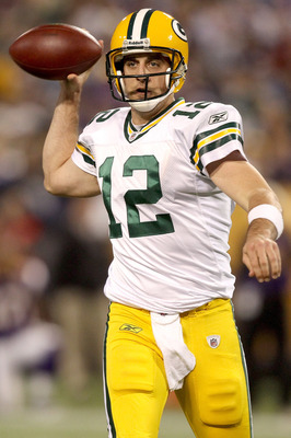 MINNEAPOLIS - NOVEMBER 21:  Quarterback Aaron Rodgers #12 of the Green Bay Packers throws against the Minnesota Vikings at the Hubert H. Humphrey Metrodome on November 21, 2010 in Minneapolis, Minnesota.  (Photo by Matthew Stockman/Getty Images)