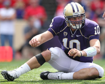 SEATTLE - SEPTEMBER 18: Quarterback Jake Locker #10 of the Washington Huskies gets up after being tackled during the game against the Nebraska Cornhuskers on September 18, 2010 at Husky Stadium in Seattle, Washington. (Photo by Otto Greule Jr/Getty Images