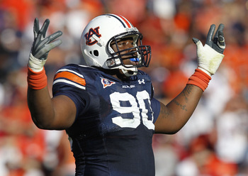 AUBURN, AL - OCTOBER 16:  Defensive lineman Nick Fairley #90 of the Auburn Tigers celebrates a play during the game against the Arkansas Razorbacks at Jordan-Hare Stadium on October 16, 2010 in Auburn, Alabama.  (Photo by Mike Zarrilli/Getty Images)