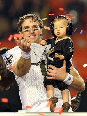 MIAMI GARDENS, FL - FEBRUARY 07:  Drew Brees #9 of the New Orleans Saints celebrates with his son Baylen Brees after defeating the Indianapolis Colts during Super Bowl XLIV on February 7, 2010 at Sun Life Stadium in Miami Gardens, Florida.  (Photo by Rona