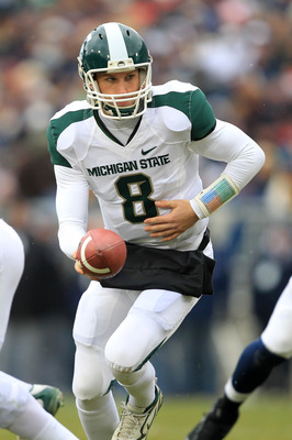 STATE COLLEGE, PA - NOVEMBER 27: Quarterback Kirk Cousins #8 of the Michigan State Spartans hands off during a game against the Penn State Nittany Lions on November 27, 2010 at Beaver Stadium in State College, Pennsylvania. The Spartans won 28-22. (Photo