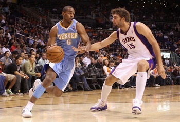 phoenix october 22 arron afflalo 6 of the denver nuggets drives great jr smith drives a tank 350x238