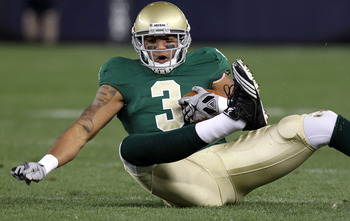 NEW YORK - NOVEMBER 20:  Michael Floyd #3 of the Notre Dame Fighting Irish loses his footing against the Army Black Knights at Yankee Stadium on November 20, 2010 in the Bronx borough of New York City.  (Photo by Nick Laham/Getty Images)