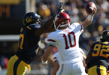 BERKELEY, CA - OCTOBER 24:  Jeff Tuel #10 of the Washington State Cougars passes against Cameron Jordan #97 of the California Golden Bears at California Memorial Stadium on October 24, 2009 in Berkeley, California.  (Photo by Jed Jacobsohn/Getty Images)