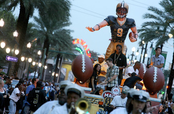 NEW ORLEANS - AUGUST 09: Former New Orleans Saints cornerback Mike McKenzie rides on a float through the streets of New Orleans during Madden Gras, celebrating the launch of EA SPORTS Madden NFL 11 video game on August 9, 2010 in New Orleans, Louisiana. T
