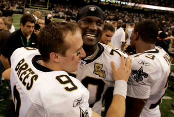 NEW ORLEANS - SEPTEMBER 25:  Quarterback Drew Brees #9 of the New Orleans Saints celebrates with teammate Jammal Brown #70 after their team's 23-3 victory over the Atlanta Falcons in the Monday Night Football game on September 25, 2006 at the Superdome in