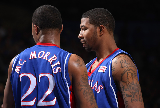 WESTWOOD, CA - DECEMBER 6:   Markieff Morris #21 and Marcus Morris #22 of the Kansas Jayhawks confer during the game with the UCLA Bruins on December 6, 2009 at Pauley Pavillion in Westwood, California.  Kansas won 73-61.   (Photo by Stephen Dunn/Getty Im